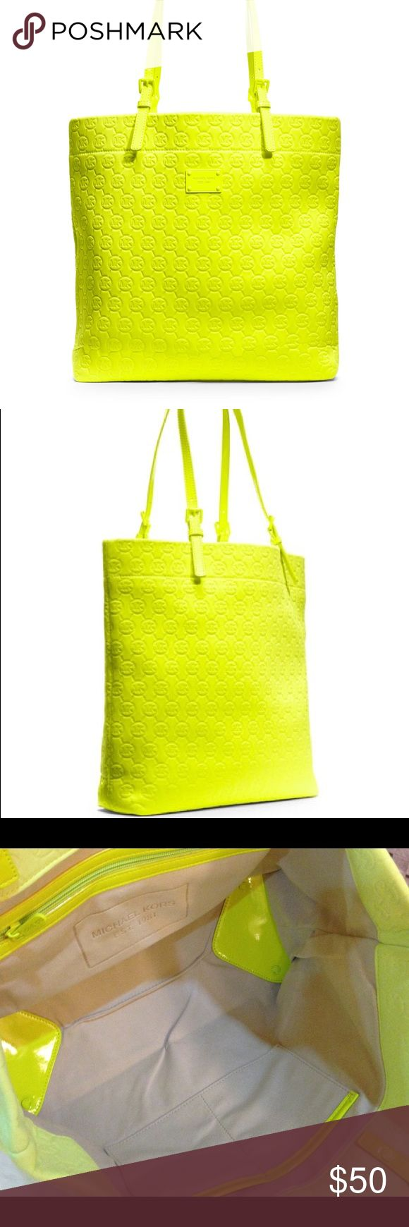 Michael Kors Neoprene Yellow Handbag Really cute as an overnight bag! Fun neon color. There is a small stain inside, but otherwise it's like new. Michael Kors Bags Shoulder Bags