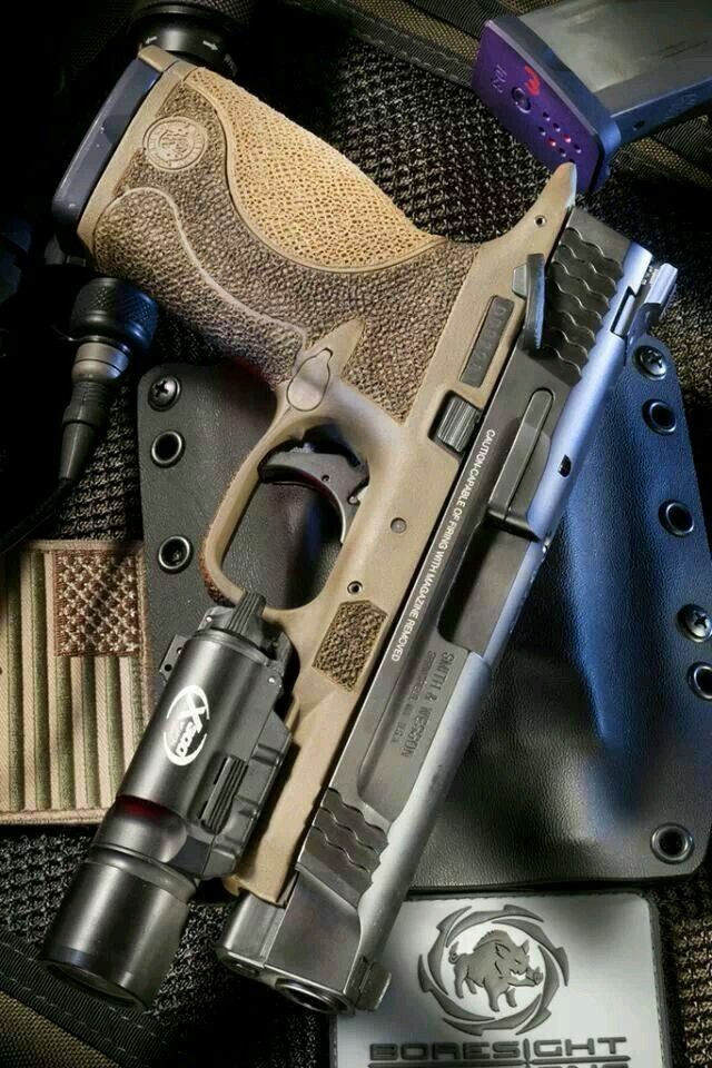 Smith & Wesson M&P-9 with stippled frame Find our speedloader now!  http://www.amazon.com/shops/raeind