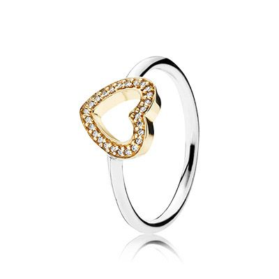Symbol of love! This elegant two-tone ring, displaying a sparkling golden heart is a meaningful present for your loved one. #PANDORA #PANDORAring #Gold #Silver