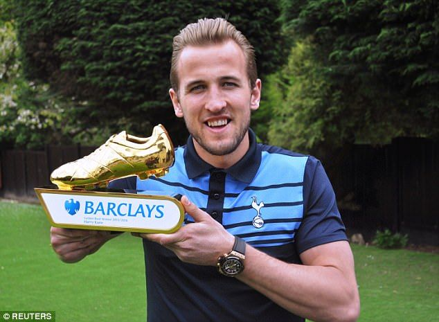 Kane poses with the 2015-16 Golden Boot - which he won with a 25-goal tally in the league