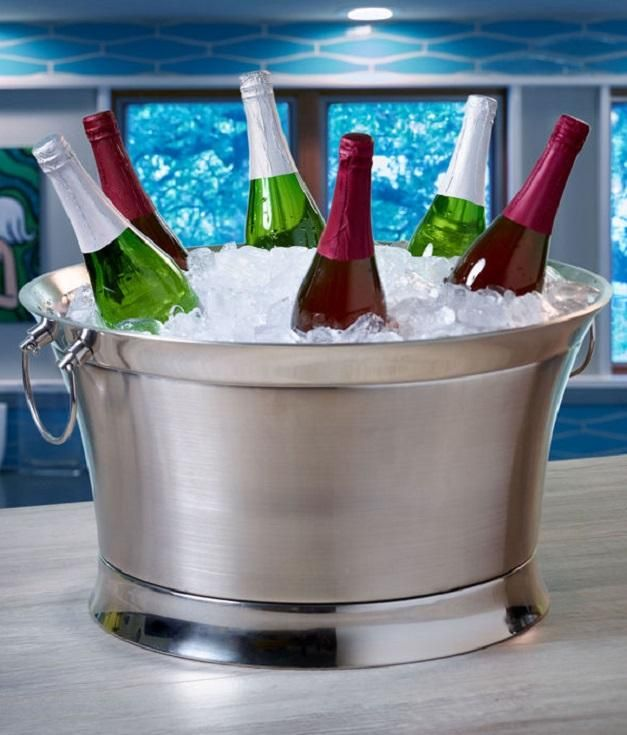 Dress up your indoor or outdoor table with this stylish stainless steel beverage tub from BirdRock Home. The double wall design keeps drinks cold without condensation.