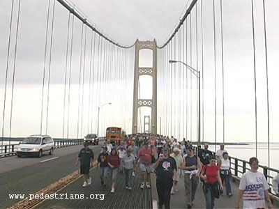 Walkers cross the Mackinac Bridge in Michigan.  The bridge walk takes place annually on Labor Day Monday.  http://www.pedestrians.org
