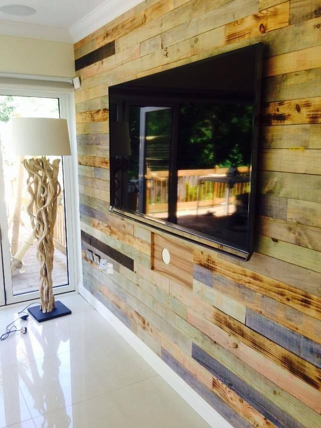 Stained and burnt pallet wood feature wall with custom red gum inlay guitar panels for the wall speaker