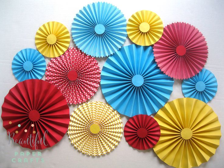 12 pc Circus/Carnival Rosettes -Paper Fans - Circus Birthday Party Decor - Paper Rosettes, Candy Buffet Decorations by BeautifulPaperCrafts on Etsy https://www.etsy.com/listing/185351818/12-pc-circuscarnival-rosettes-paper-fans