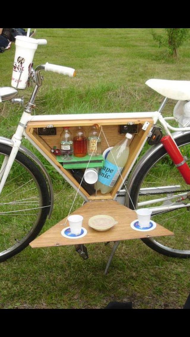 Picnic box built into bike frame with a cover that doubles as a folding table top.