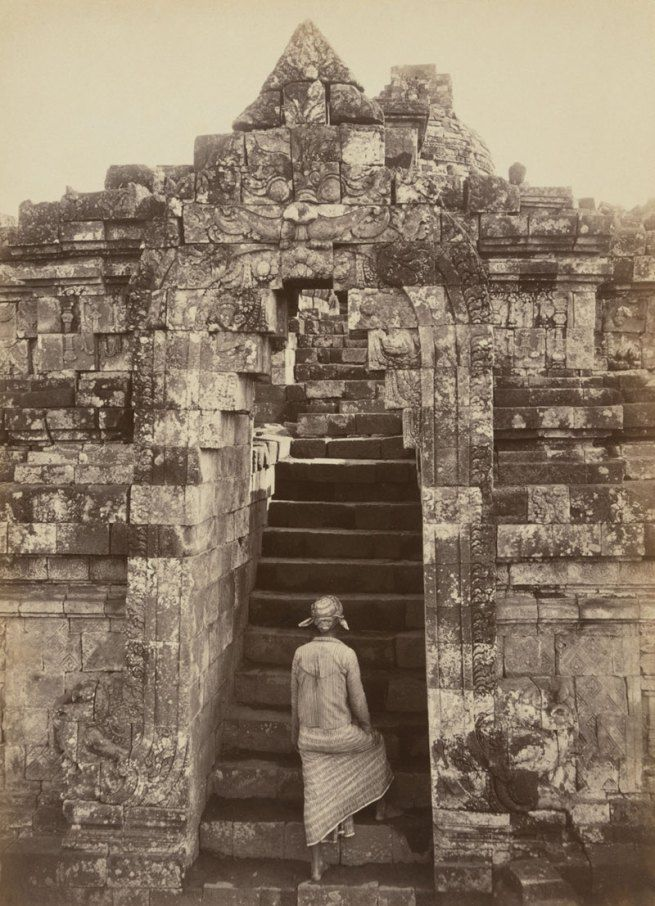 liquidnight:Kassian Céphas Man climbing the front entrance to Borobudur Central Java, 1872 Albumen silver photograph [via Art Blart]