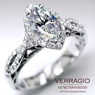 Stunning, twisted pave band, with a marquis cut diamond surrounded by halo. I WANT THIS RING!!