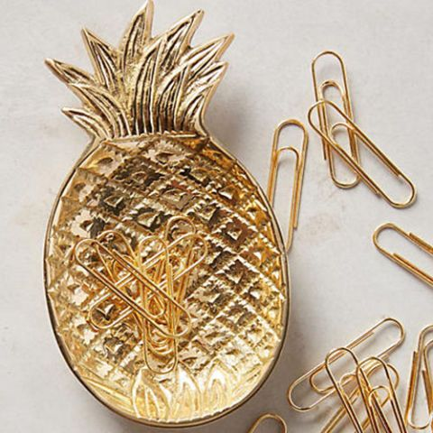 15 Food-Themed Desk Accessories You Need for Your Office: Ananas Trinket Dish & Clips. Though it doesn't look exactly like the real thing, it does give off the same tropical vibes. Use this little dish for the paperclips it comes with, or to store any other little office trinkets you need a place for.