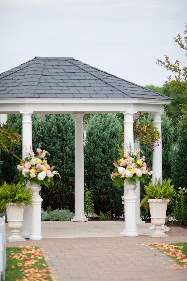 Bright Colorful Ceremony Pedestal Arrangements And Aisle Lining Petals Moon Weddingblue