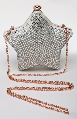 Star-shaped evening bag with rhinestones, can be worn with shoulder chain (chain can be hidden in bag or removed), or be held as a clutch. 15 cm width at widest point.
