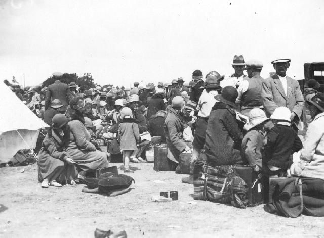 Refugees, Napier.  A photograph of people gathered, possibly at Nelson Park, after the Hawke's Bay earthquake on the 3rd of February 1931. Photographer, Les White. Post 03 Feb 1931