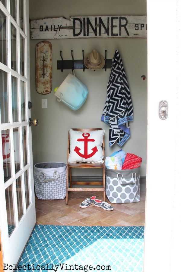 Summer mudroom - such great decorating and storage ideas! Love the HomeGoods canvas baskets, anchor pillow and colorful beach towels #HomeGoodsHappy #HappybyDesign #sponsored eclecticallyvintage.com