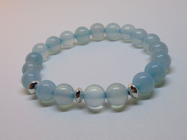 Blue Chalcedony Beaded Bracelet with 925 Sterling Silver Accents. It is a stone that absorbs negative energy and diminishes hostile feelings. It encourages kindness and generosity  and helps to accept new situations easily...