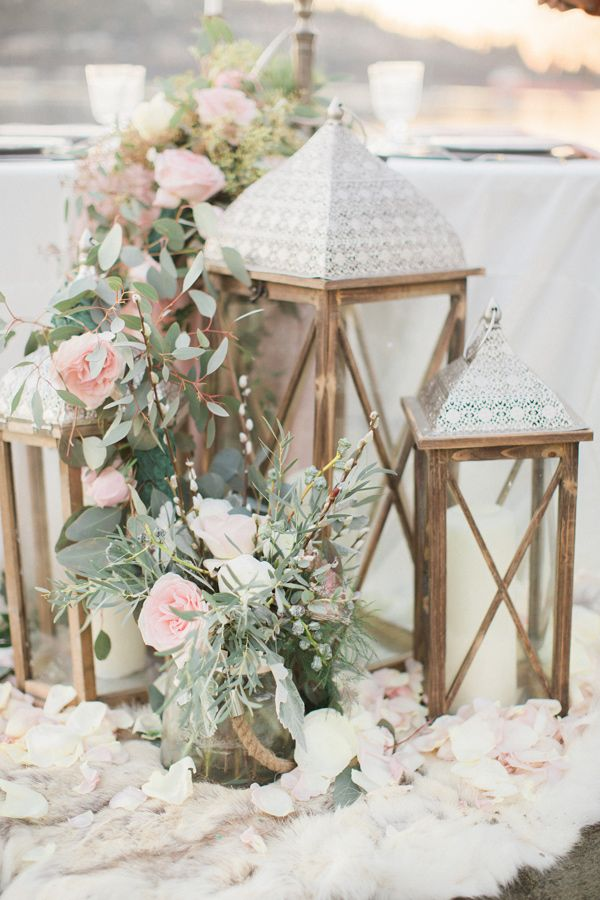 lanterns with flowers - photo by Simply Sweet Photography by Nomo Akisawa http://ruffledblog.com/nordic-beach-wedding-inspiration