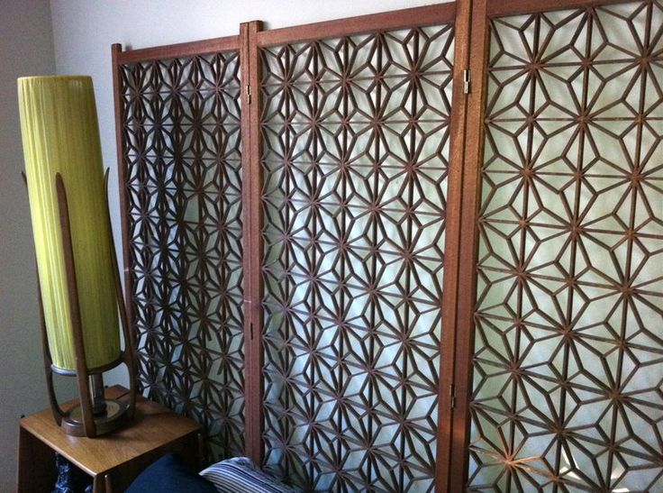 Use A Decorative, Mid-century Living Room Screen As A