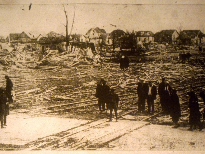 People look at ruins of the Chicago and Eastern Illinois Railroad in the small town of Griffin in the northwest corner of Posey County on March 18, 1925 after a tornado completely leveled structures in its path.