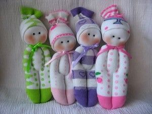 Sock doll tutorial - broken English instructions but pictures at the different stages.  Think I can figure it out.  So sweet.