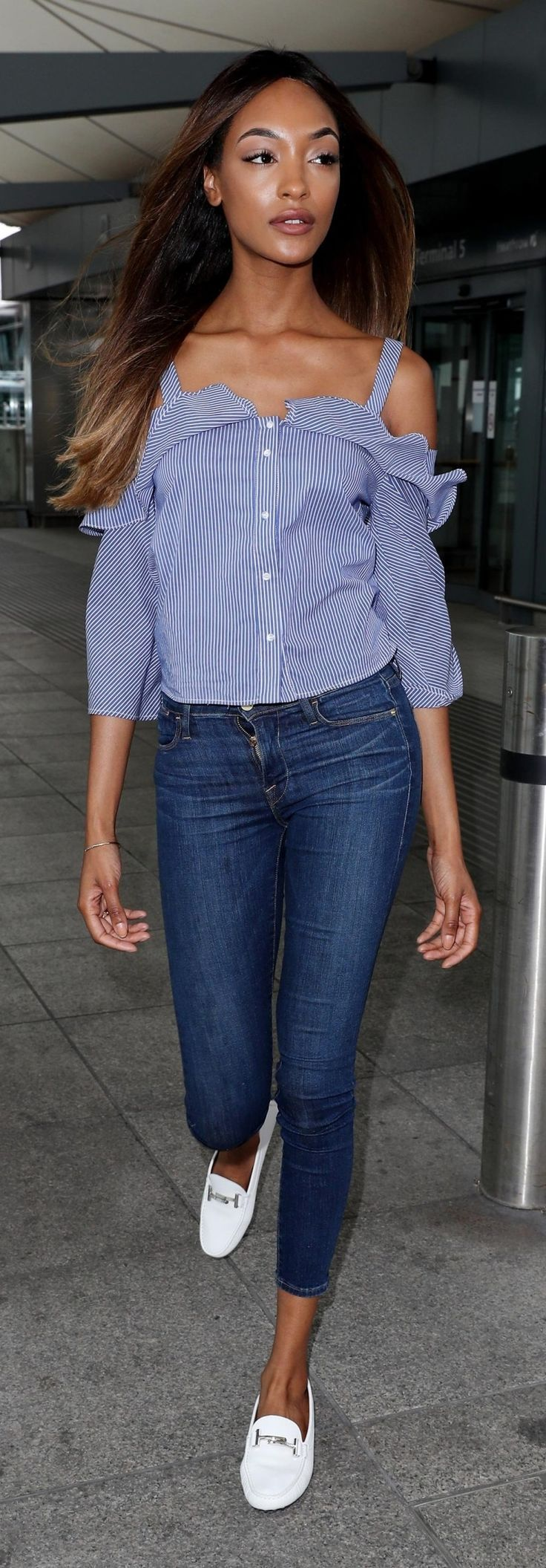 Jourdan Dunn wears white Tod's Gommino loafers with an off-the-shoulder top and skinny jeans.