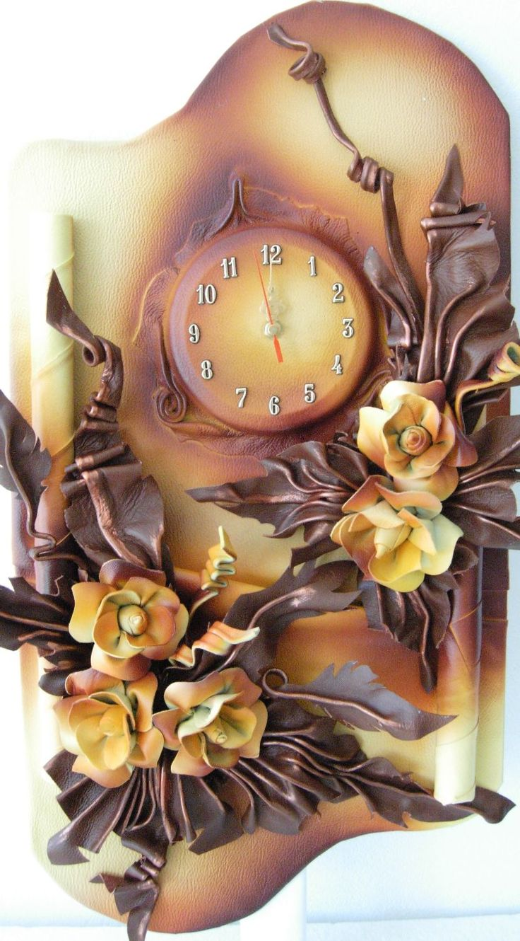Unique 3D Leather Art -Five Flowers with Clock  Size: 38cm x 70cm  Color: Light and Dark Brown, Gold, Walnuts, Orange,Burgundy  Material: Genuine Leather,  Wood Clock requires one R6 –AA battery to operate (not included)  Using silent motor  Ships well protected