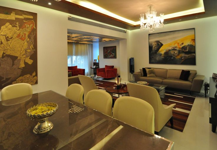 Dining Area cum Living Room with gray chairs-design by  Interior Designer: Kayzad Shroff, India.