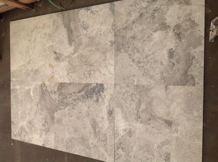 Alaskan grey floor tiles, hues of blue, grey  white. A beautiful statement floor