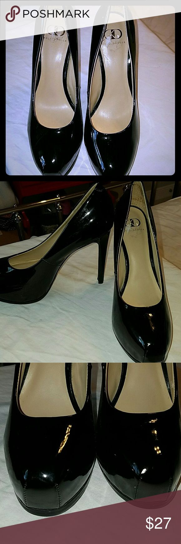 "Patent leather pumps Black patent leather pumps with platform with 6"" thin heel. Worn once. Kelsi Dagger Shoes Platforms"