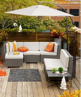 Modern wicker furniture for the deck.