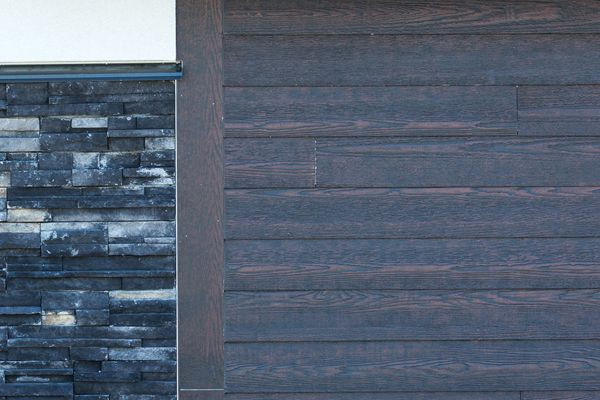 RusticSeries Lap Siding on Allura Fiber Cement. Faux Wood Look, Color is Roasted Walnut. Beautiful commercial design architecture.