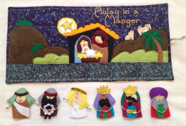 Nativity felt finger puppets and stable.