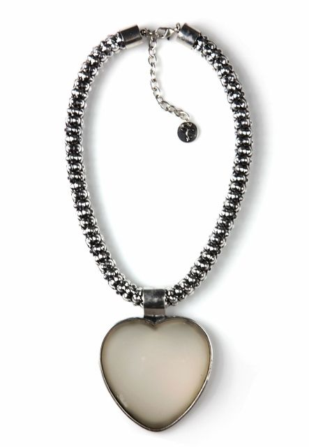 Entice - Silver Large Heart Necklace.  Indulge a bit of dark romance with this silver heart pendant necklace. Entice is just sweet enough, with its heavy, minimalist chain and moody vibe. The domed, resin-look heart pendant is semi-transparent and luminous over bare skin. You have a heart, the look says, but it's hardly worn on your sleeve. http://www.byariane.com.au/Sistaco-Entice