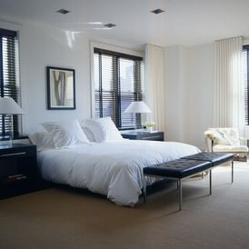 contemporary bedroom with ceiling mounted ripple fold pleated curtains