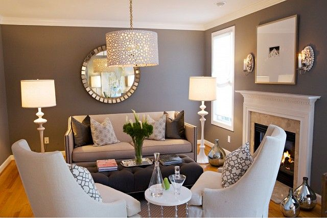 Good design for small space. Not cluttered, yet not so spare it's uninviting. Repeating element in drum shades helps unify. Note the counterintuitive touch: bringing the furniture in a little from the walls conveys the impression there is extra space, not less.