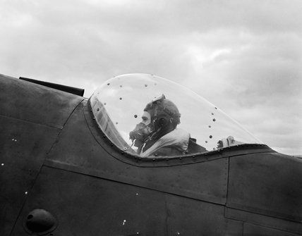 The navigator of a No. 125 Squadron Bristol Beaufighter MK VIF settles into his position, ready for another night patrol from Exeter, 14 September 1943.
