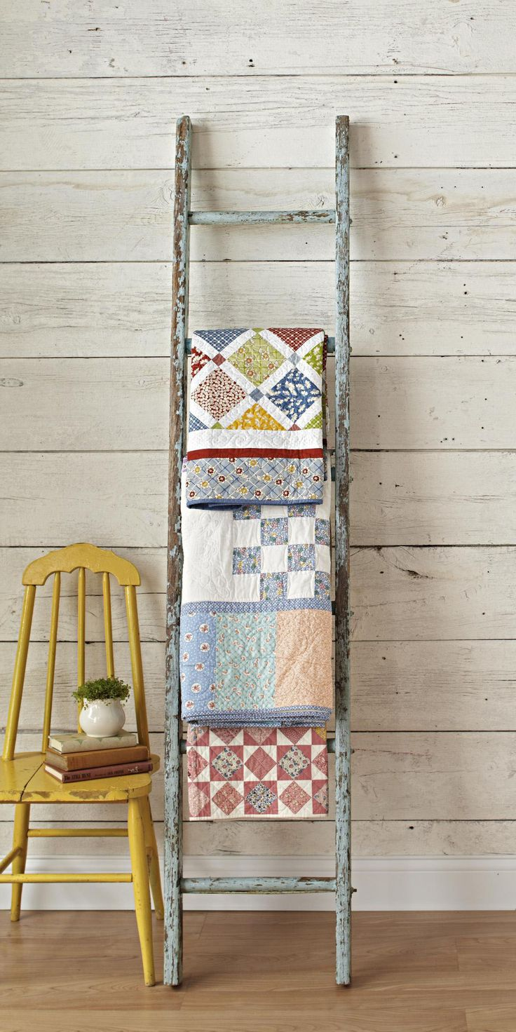 Revive An Old Ladder To Display Quilts   Great old ladder,  available at The Briar Patch $20.00