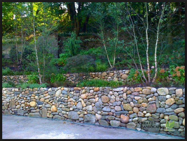 Round river rock multi colored retaining walls for River rock wall