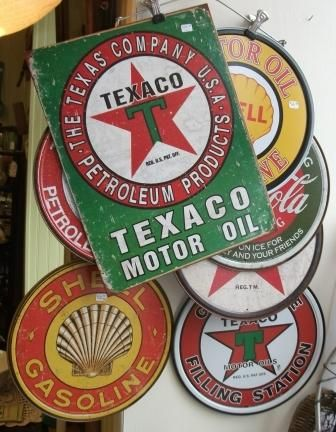 Reproduction of Antique Metal Signs and Thermometers.