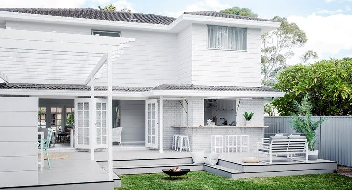 Total transformation - Hamptons-style haven. Extending the existing platform on either side and creating a servery has made the outdoor area at the rear of the home an entertainer's dream   Home Beautiful magazine Australia