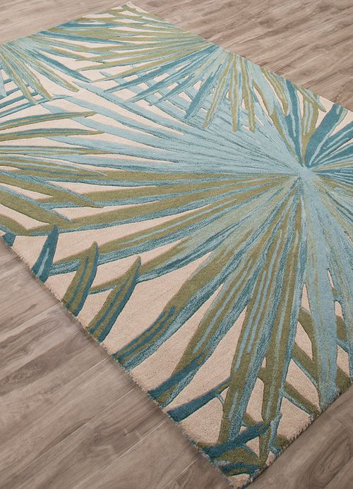 Striking a perfect balance between tropical motif and barefoot coastal comfort, this hand-tufted, rich pile Palmetto Luxury Seaside rug in 100 percent wool with a palm frond design in shades of fog and smoke blue, expresses a rich island style.
