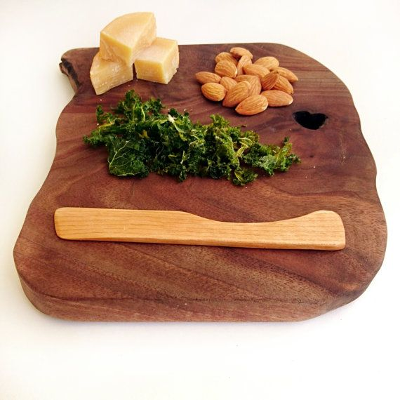 Reclaimed cheese knife and live edge cheese board sprinkled with cheese,  almonds and kale chips by B EN T Art & Accessories www.BENTartaccessories.etsy.com