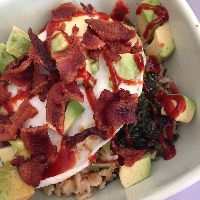 Organic rolled oats, chopped kale, gluten free soy sauce, sunny side up egg, diced avocado, organic bacon and Sriracha! http://healthyfitandbarefoot.wordpress.com