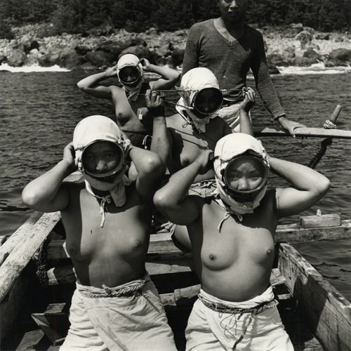 Horace Bristol :Diving Girls of Hatsushiima Donning Masks before Diving, 1947 * The Japanese believe that the majority of ama (divers) are women because of how their bodies differ from men: The fat on a female body is distributed differently than on men, which ensures that they can stay warmer in colder water. (Wiki)