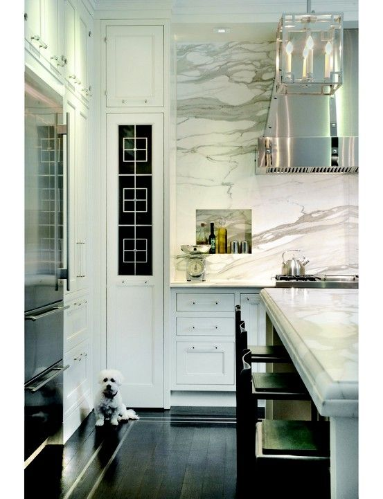 Beautiful Kitchen... dark floors, marble, lucite hardware | More decor lusciousness here: http://mylusciouslife.com/photo-galleries/architecture-and-design-beautiful-buildings-gardens-and-decor/