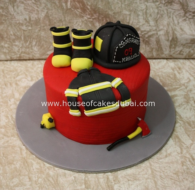 Fire fighting cake by The House of Cakes Dubai, via Flickr