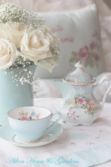 Lovely cup and tea pot love the blue  and pink roses