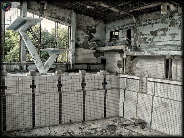 Views of current Chernobyl. Very haunting photos of hurriedly abandoned places. An old swimming pool.