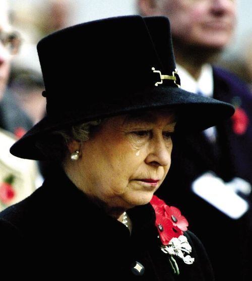 """""""You don't see the Queen crying very often. This was the first Remembrance Day service after her mother died – the Queen mother used to lay the wreath every year.    The Queen stood in for her and was visibly upset. I felt quite emotional as I saw the tears roll down her face.    Prince Philip has laid the wreath ever since."""" - Kent Gavin, the photographer."""