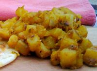 Aloo Curry - Curried Potatoes - delicious comfort food on its own, added thyme and left out the cumin. good side dish.