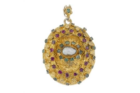 An Austro Hungarian gem-set and enamel locket. Of oval outline with engraved scrolling acanthus l