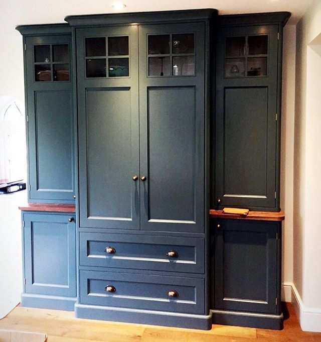 A kitchen pantry or dresser. Designed and built to fit into this space and around our clients needs and lifestyle. Painted in Farrow and Ball Inchyra Blue.