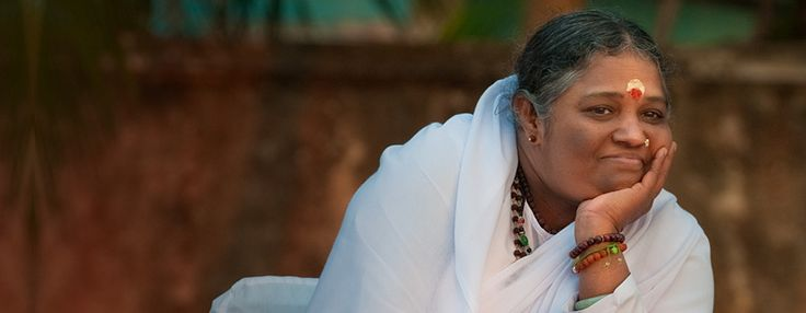 AMMA, the woman embracing the world. She lives each day expressing compassion. So inspiring.